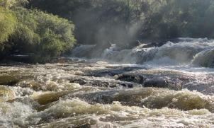 River rapids after the rain - sunshine and spray